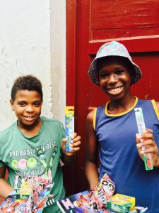 Young cubans happy with their new toothbrushes